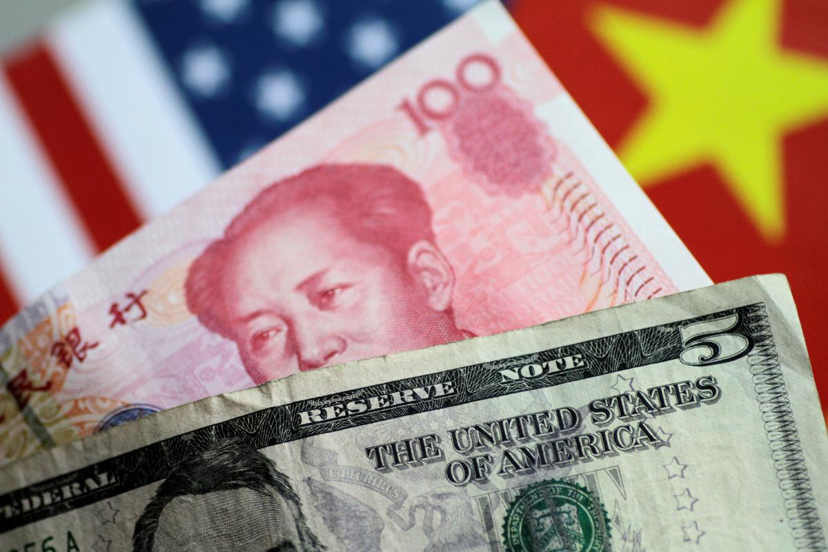 China fixes yuan above 7 per Dollars  for first time since 2008